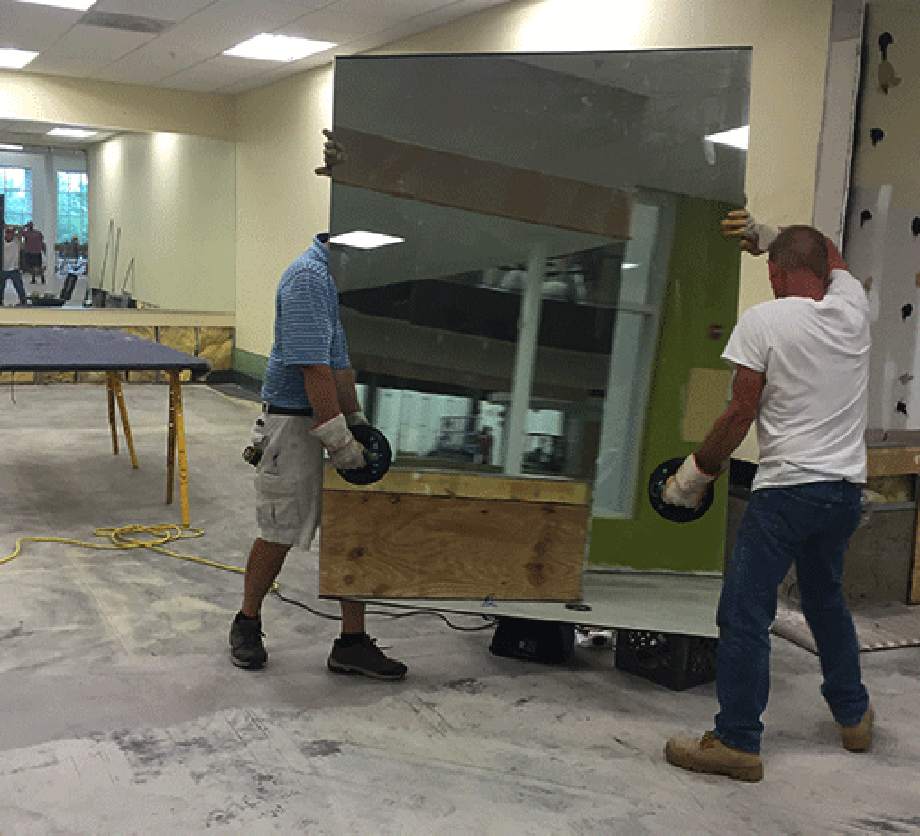 Grossman Mirrors' Glaziers | Mirror Wall Installation | LA Fitness